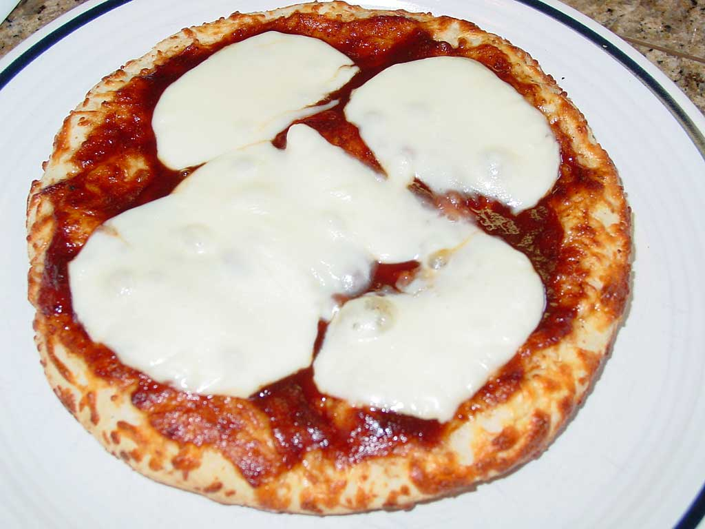 Bake the crust with sauce and cheese before adding barbecue