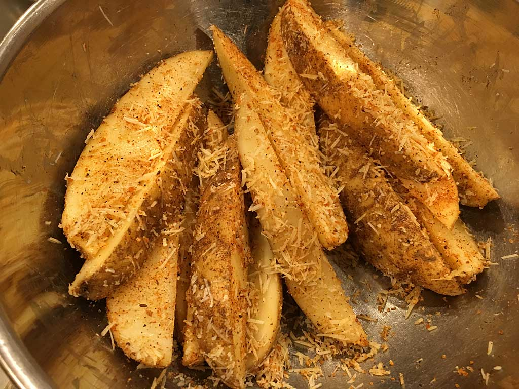 Wedges coated in olive oil, parmesan cheese and barbecue rub