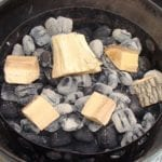 Wood chunks spread over hot coals