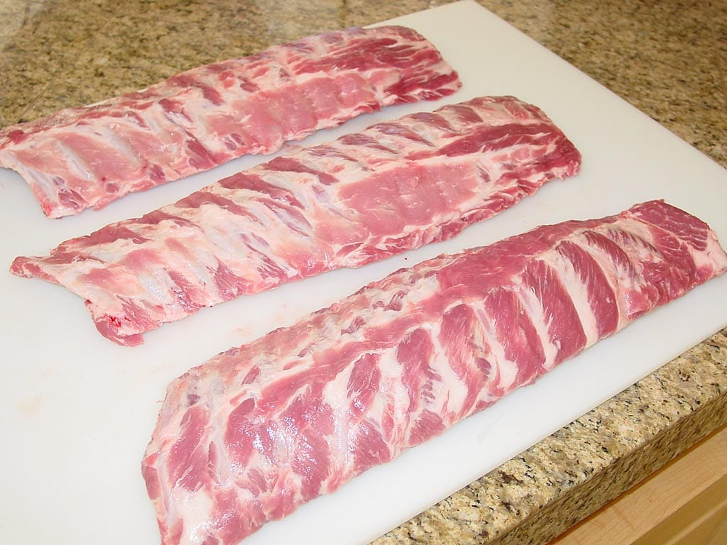 Three slabs of pork loin back ribs