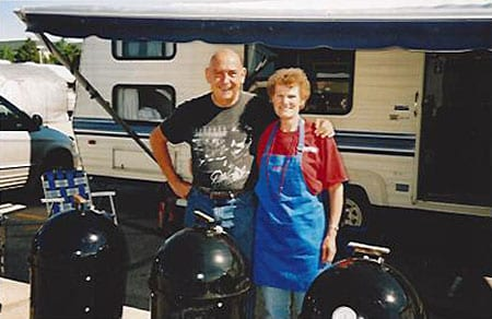 Mike Scrutchfield and Donna McClure of P.D.T. (Pretty Damn Tasty, another epic WSM team from the 1990s) pose with Weber smokers at the Great American Barbecue in Kansas City, Memorial Day Weekend 2005.
