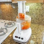 Grating carrots in a food processor