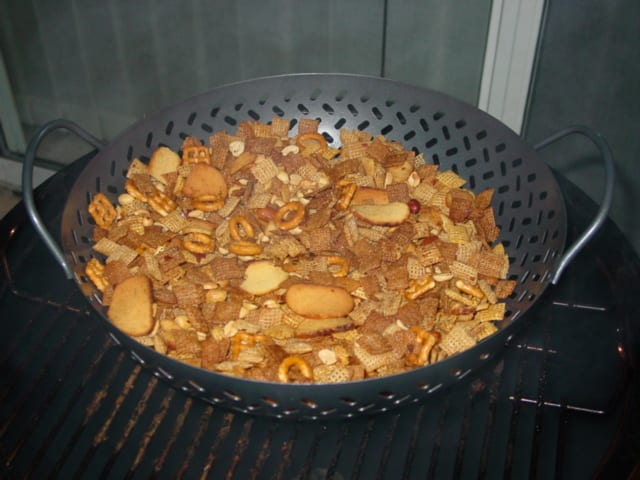 Chex party mix made in the Weber Smokey Mountain Cooker