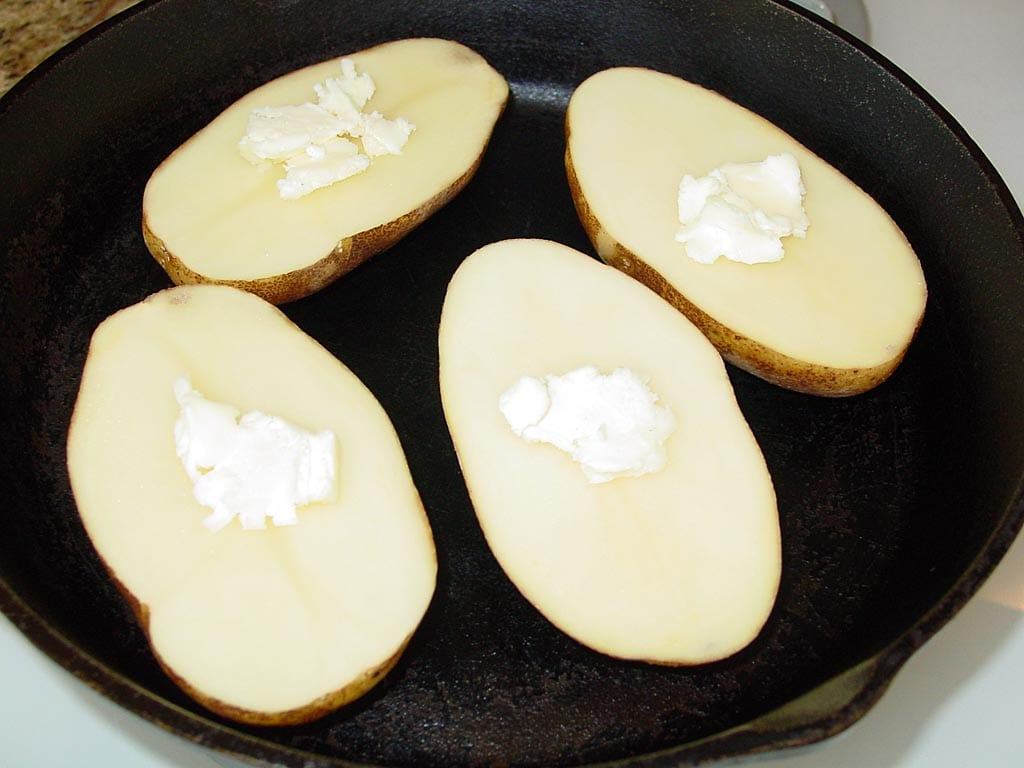 Raw potato halves with butter