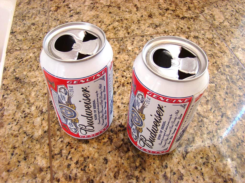 Two beer cans prepared for chicken insertion