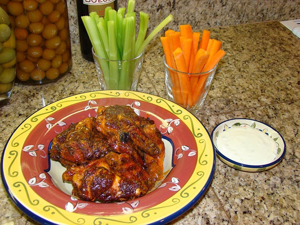 Buffalo wings served with celery sticks, carrot sticks, and blue cheese dressing