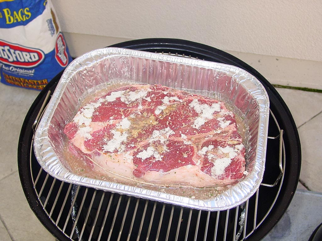 Chuck roast goes into the cooker