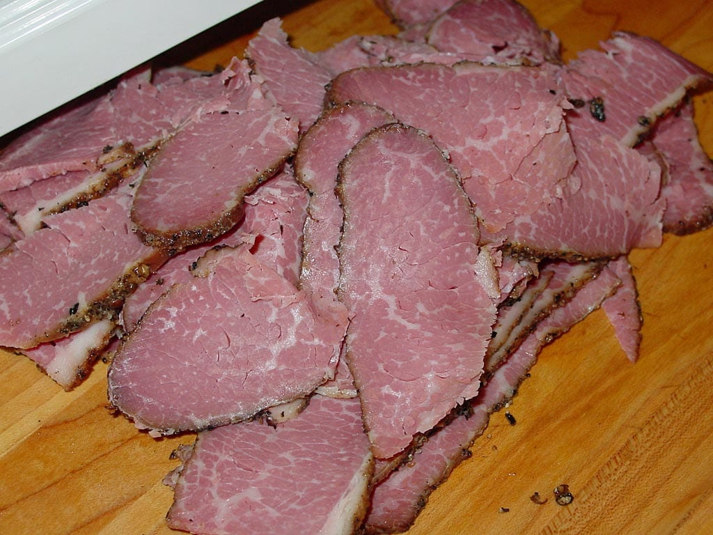 Slices of homemade pastrami smoked in the Weber Bullet