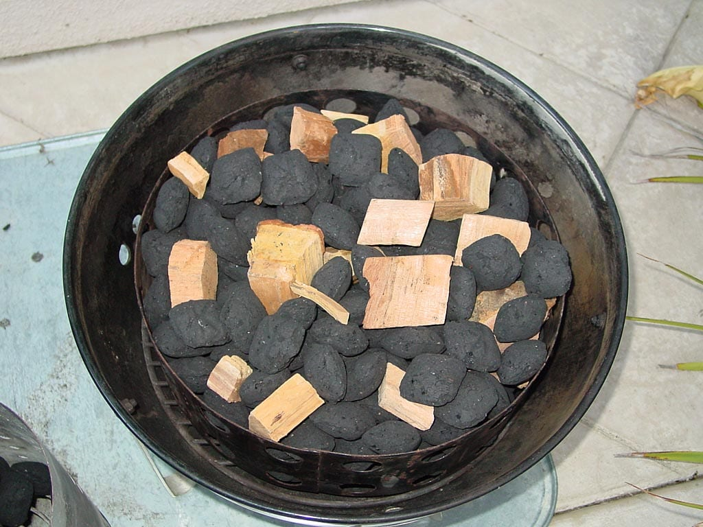 Smoke wood mixed into unlit Kingsford charcoal briquettes
