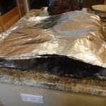 Folding foil over pork butt