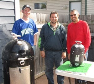 Tony Koury (in red) with friends and WSM cake