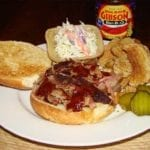Championship injected pulled pork sandwich and side dishes