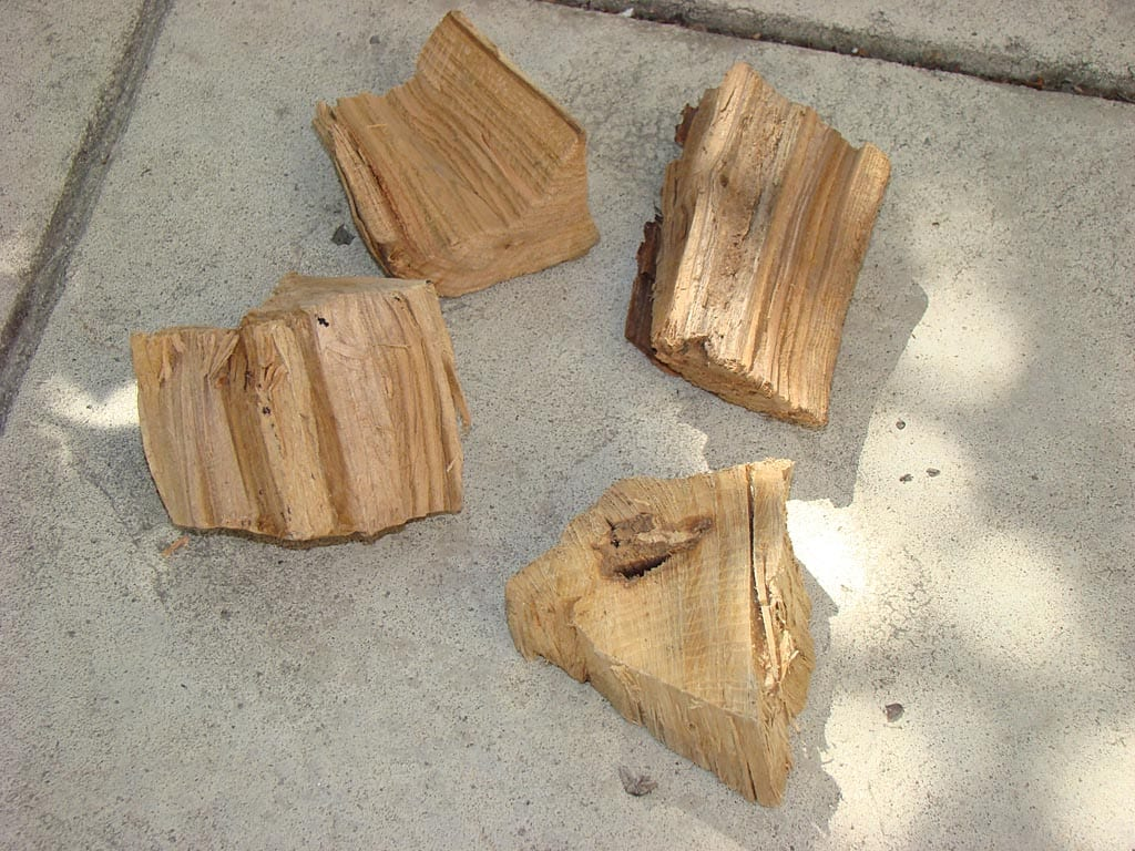 Three chunks of apple wood, one chunk of hickory wood