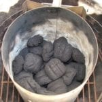 Half full Weber chimney of unlit Kingsford charcoal