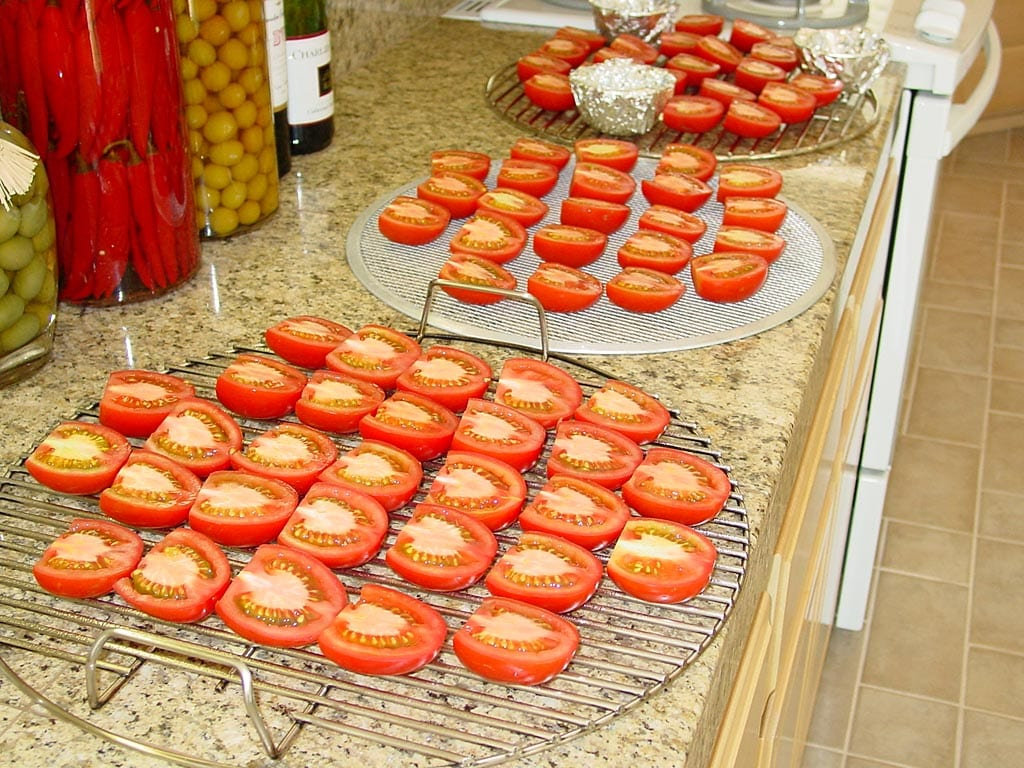 Tomato halves arranged on grates