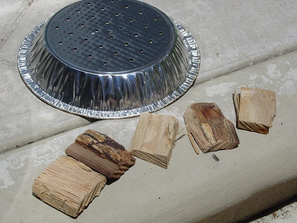 Perforated pie tin and smoke wood