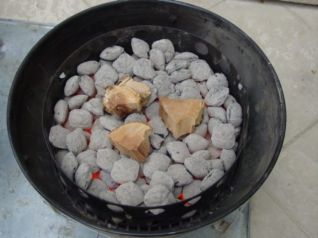 Hot coals with apple wood applied