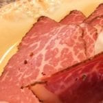 Profile view of 1mm thick pastrami slices