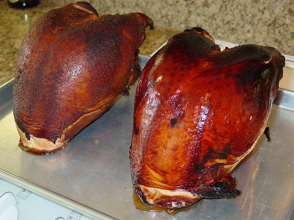 Two bone-in turkey breasts after barbecuing