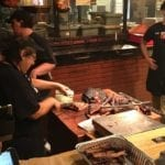 Meat cutting behind the counter