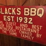 Sign touting Black's as one of the oldest joints in Texas