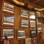 Old high school football team photos adorn the walls