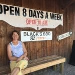 My wife Julie sitting in front of Black's Barbecue