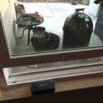 Smoke base unit next to smoker, WiFi gateway in window sill
