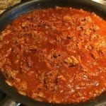 Brisket and ground beef chili simmering in skillet