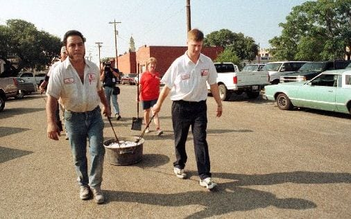 Roy Perez and Lehman Schmidt dragging hot coals to the new Kreuz Market, August 30, 1999