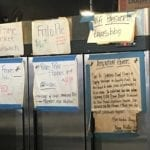 Lots of signs on white butcher paper
