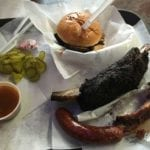 Our food order: brisket sandwich, beef short rib, sparerib, and sausage link