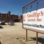 Smitty's Market sign and parking log