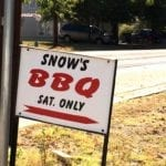 Street sign pointing the way to Snow's BBQ