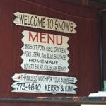 Menu sign on the porch at Snow's BBQ