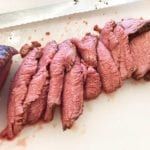 Thin slices of tri-tip carved by hand