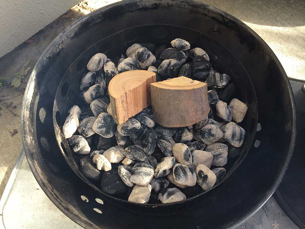 Apple wood chunks placed on hot charcoal