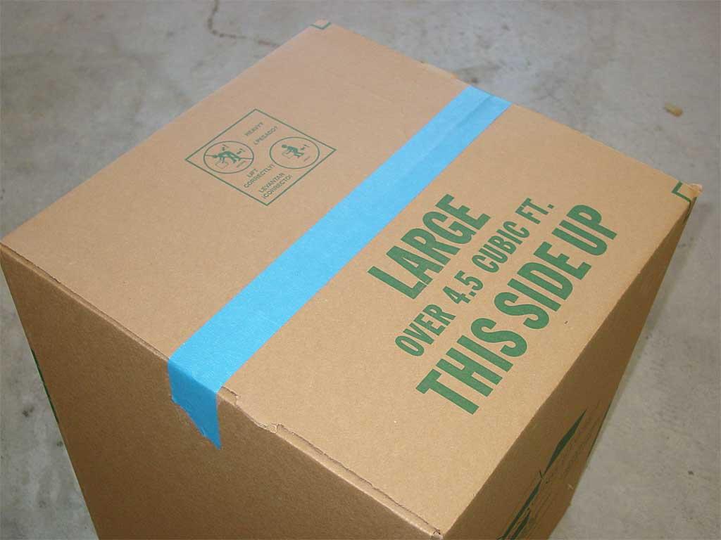Taping the cardboard box
