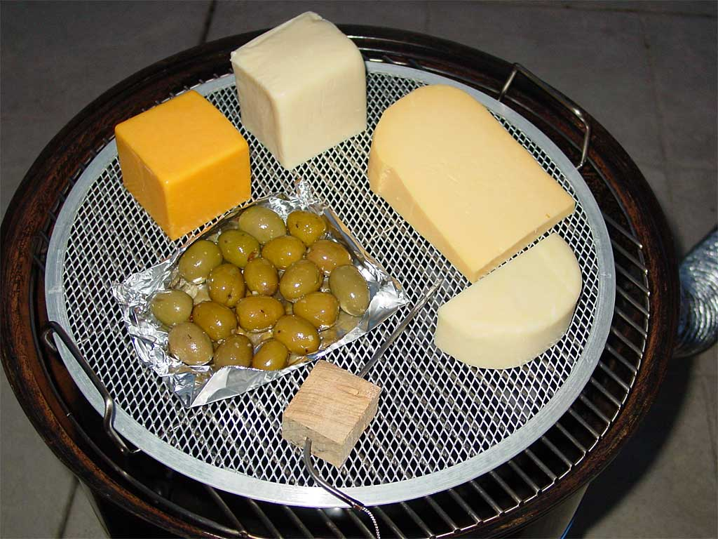 A variety of cheeses and olives for cold smoking
