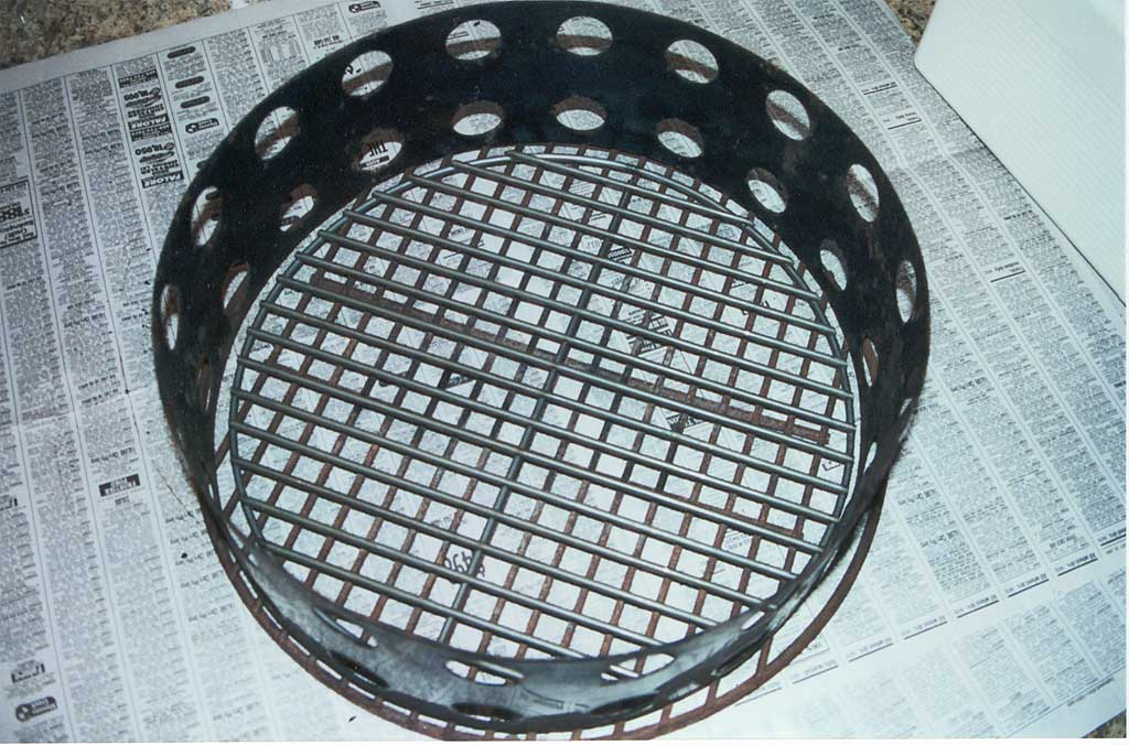 Two crossed charcoal grates