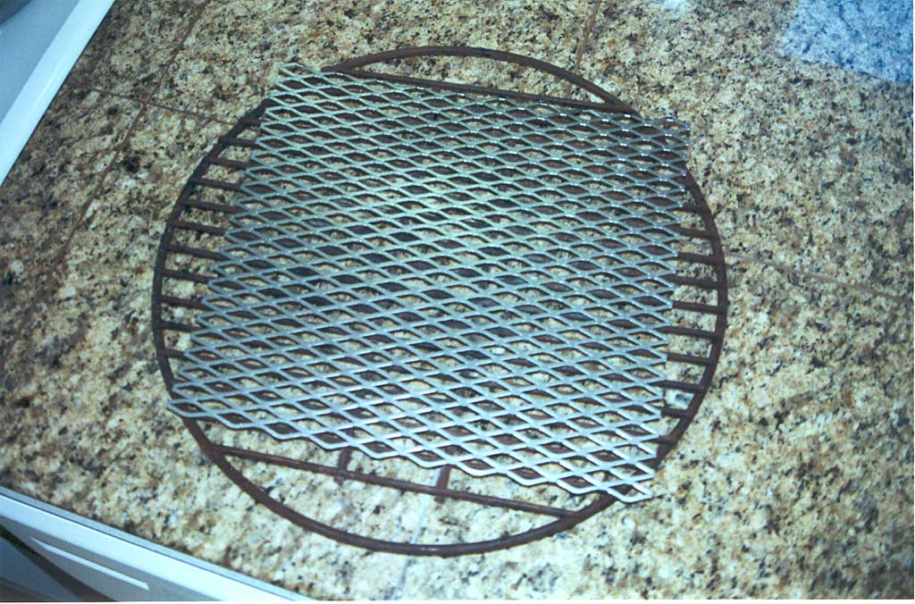 Charcoal grate with expanded metal
