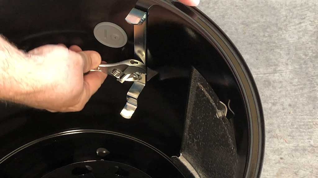 Removing bottom nut from grills strap