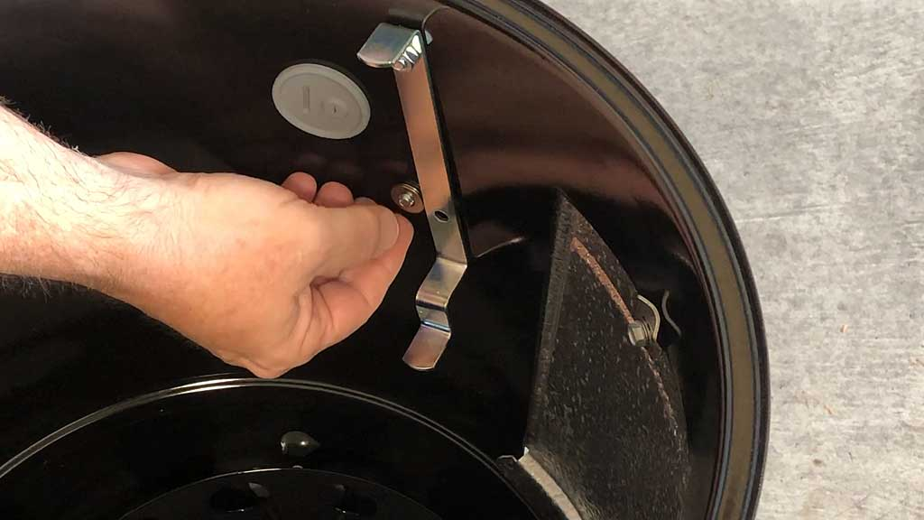Placing washers over screw
