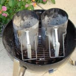 Two Weber chimney starters on charcoal grate