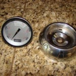 Thermometer and bezel removed from lid