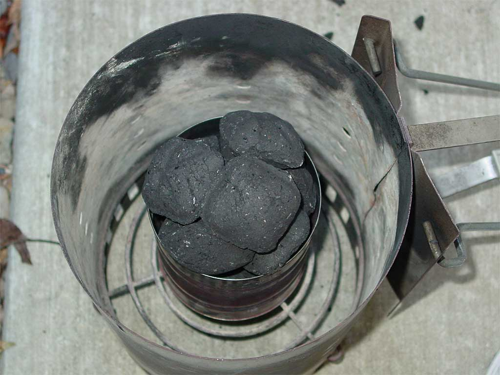 20 briquettes in a bottomless coffee can inside a chimney starter