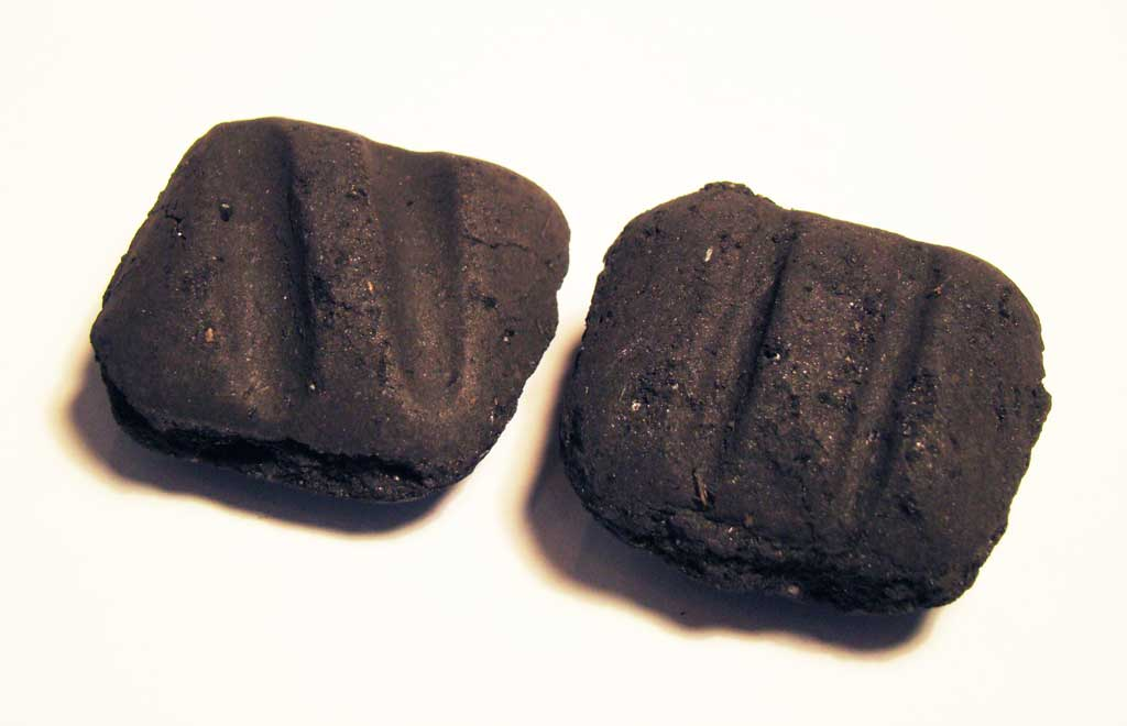 Deeper, diagonal Sure Fire Grooves (left) are pressed into each 2010 formula Kingsford briquette.
