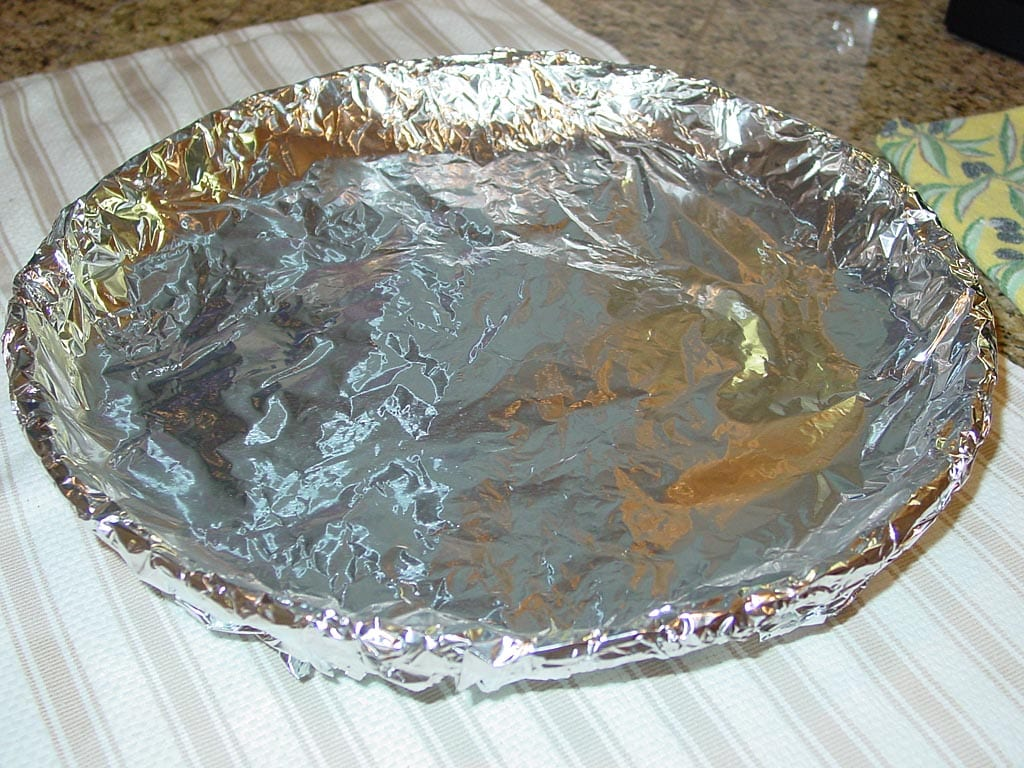 Sand covered with foil