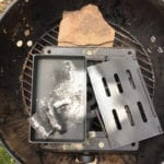 Smoker box on top of cast iron stove