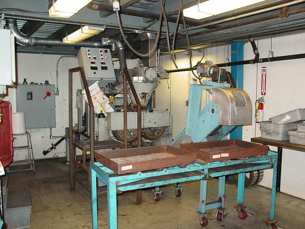 The R&D briquette press. Much larger machines are used to make briquettes at regional production facilities around the United States.